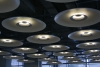 Rows of lamps in the departure hall of Madrid airport