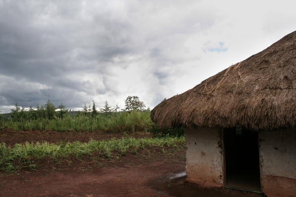 Storm clouds brewing over a village in Ituri