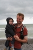 Wolf and daddy on a very windy beach