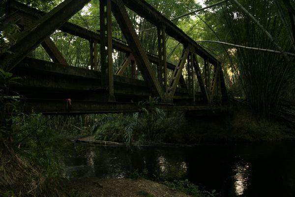 Old metal bridge over Lekedi river
