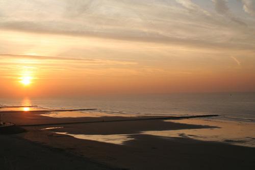 Sunset over the beech in Middelkerke